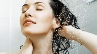 woman-rinses-hair